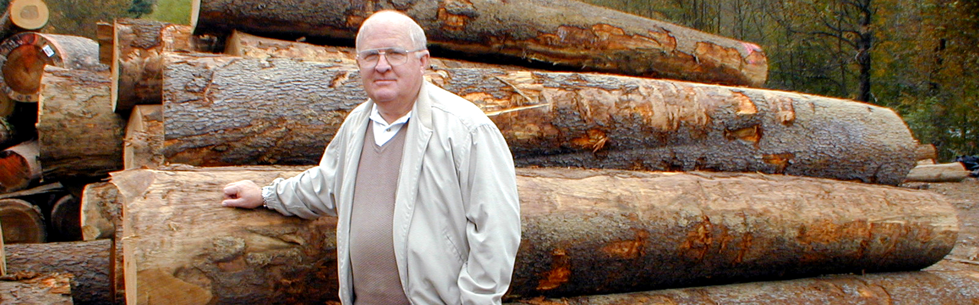 Jim C Hamer by the logs